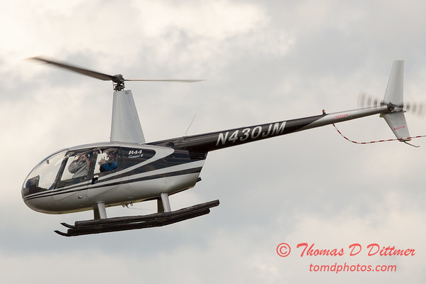 91 - Photographers in a Robinson R44 Helicopter survey Wings over Waukegan 2012