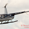 88 - Photographers in a Robinson R44 Helicopter survey Wings over Waukegan 2012