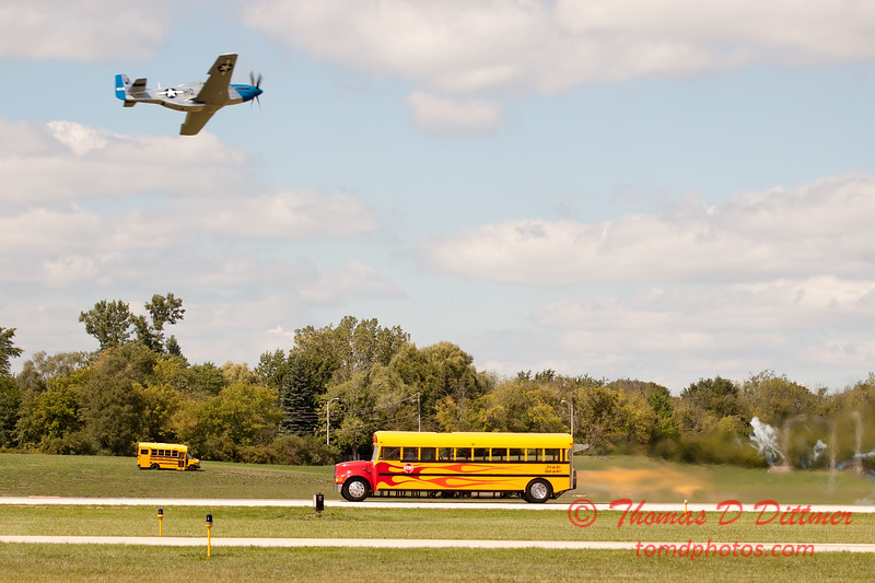 "899 - Vlado Lenoch flies by the crowd in preparation for his ""race"" with Paul Stender and the Indy Boys School bus at Wings over Waukegan 2012"