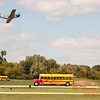 """899 - Vlado Lenoch flies by the crowd in preparation for his """"race"""" with Paul Stender and the Indy Boys School bus at Wings over Waukegan 2012"""