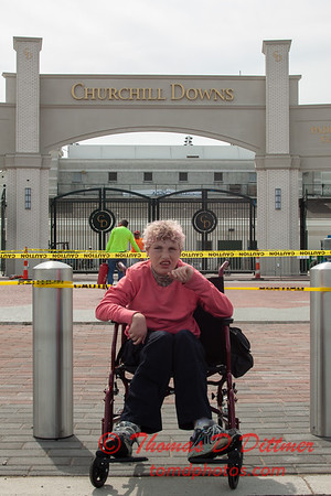 Aubrey in front of an entrance to Churchill Downs