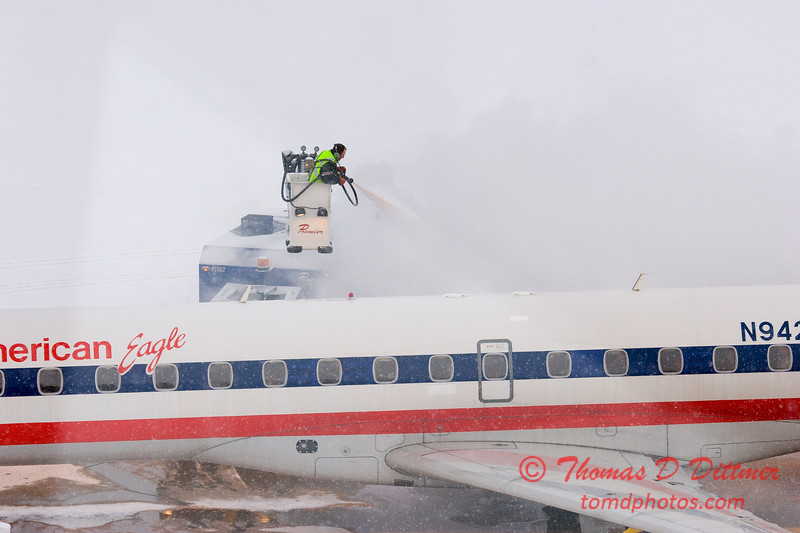 5 - American Eagle is deiced at the gate prior to departure - Greater Peoria Regional Airport - Peoria Illinois - Sunday January 25th 2009