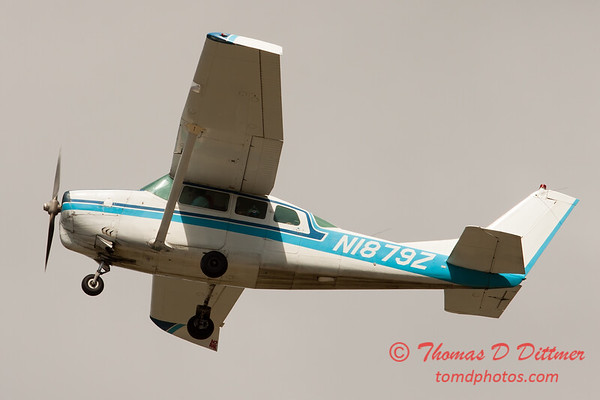 62 - The Liberty Parachute Team in their Cessna C210 Centurion depart Wings over Waukegan 2012
