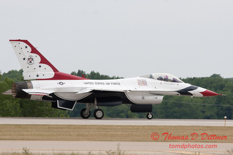 1231 - US Air Force Thunderbirds return to earth after their Sunday performance in F16 Fighting Falcons at the 2012 Rockford Airfest - Chicago Rockford International Airport - Rockford Illinois - Sunday June 3rd 2012