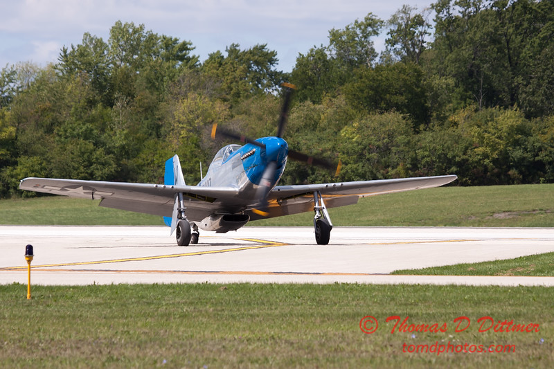 943 - Vlado Lenoch and his P-51 returns to earth at Wings over Waukegan 2012