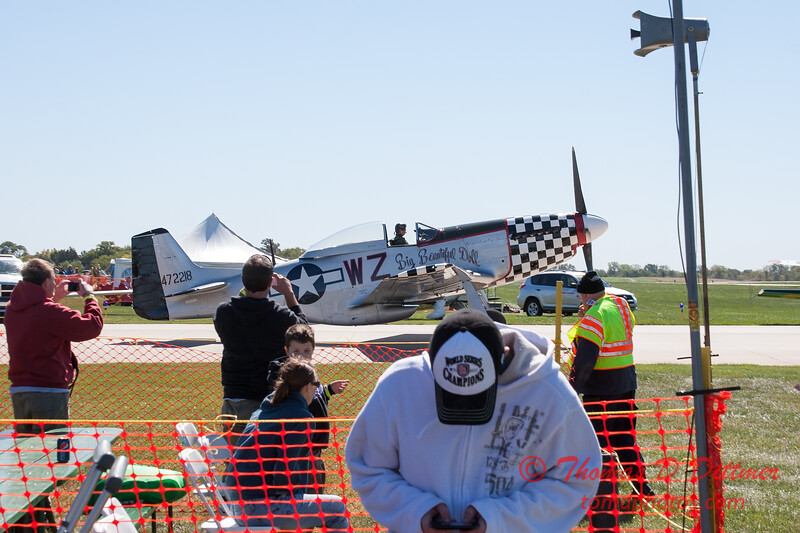 357 - A North American P51 taxies for departure at the South East Iowa Air Show in Burlington Iowa