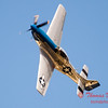 """917 - Vlado Lenoch and his P-51 executes a Victory Roll after the """"race"""" with Paul Stender and the Indy Boys School bus at Wings over Waukegan 2012"""