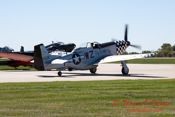 359 - A North American P51 taxies for departure at the South East Iowa Air Show in Burlington Iowa