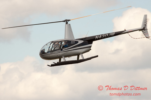 89 - Photographers in a Robinson R44 Helicopter survey Wings over Waukegan 2012