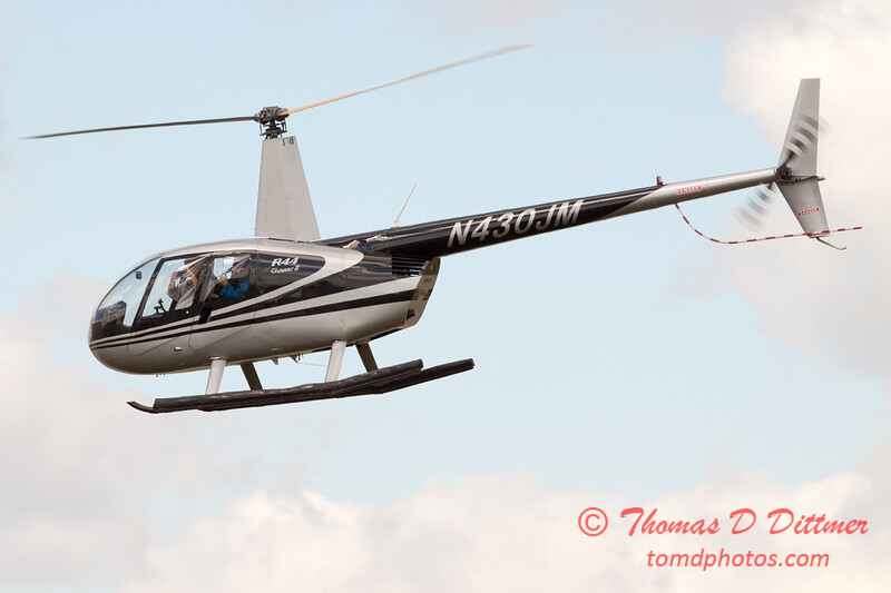 95 - Photographers in a Robinson R44 Helicopter survey Wings over Waukegan 2012