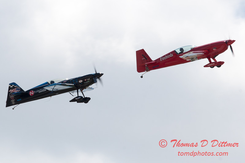 425 -  Rob Holland in the MX 2 and Jack Knutson in his Extra 300S ready for the Firebird Xtreme performance at the 2012 Rockford Airfest - Chicago Rockford International Airport - Rockford Illinois - Sunday June 3rd 2012