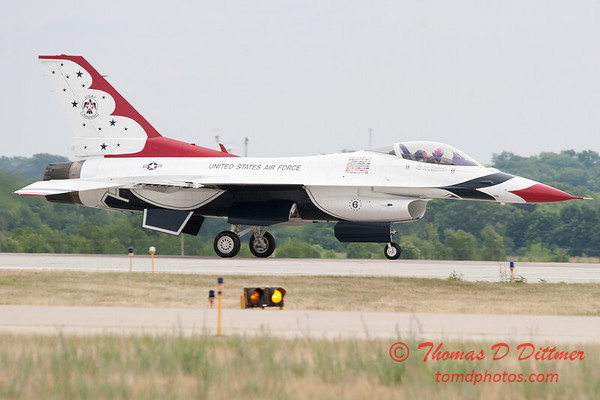 1229 - US Air Force Thunderbirds return to earth after their Sunday performance in F16 Fighting Falcons at the 2012 Rockford Airfest - Chicago Rockford International Airport - Rockford Illinois - Sunday June 3rd 2012