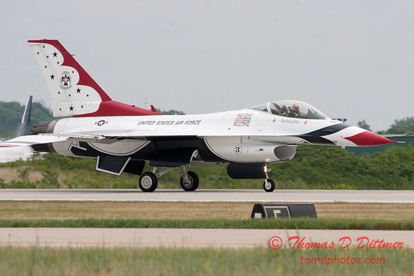 1207 - US Air Force Thunderbirds return to earth after their Sunday performance in F16 Fighting Falcons at the 2012 Rockford Airfest - Chicago Rockford International Airport - Rockford Illinois - Sunday June 3rd 2012