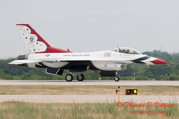 1208 - US Air Force Thunderbirds return to earth after their Sunday performance in F16 Fighting Falcons at the 2012 Rockford Airfest - Chicago Rockford International Airport - Rockford Illinois - Sunday June 3rd 2012