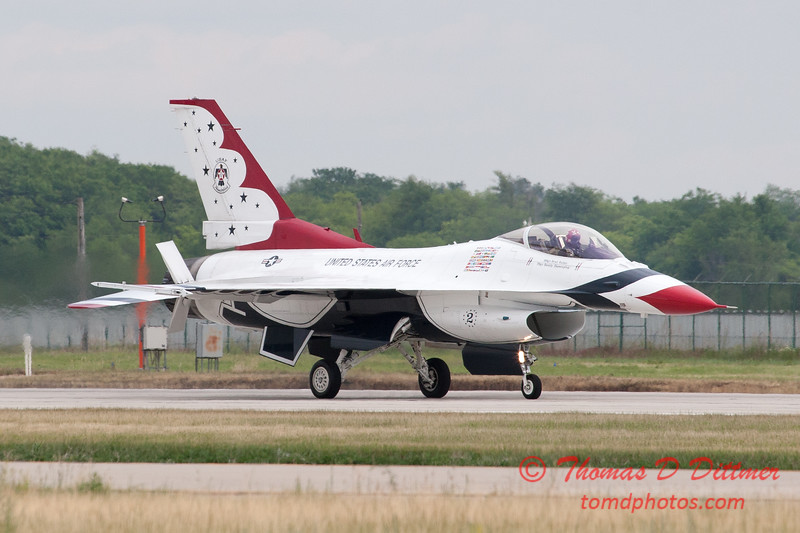 1203 - US Air Force Thunderbirds return to earth after their Sunday performance in F16 Fighting Falcons at the 2012 Rockford Airfest - Chicago Rockford International Airport - Rockford Illinois - Sunday June 3rd 2012