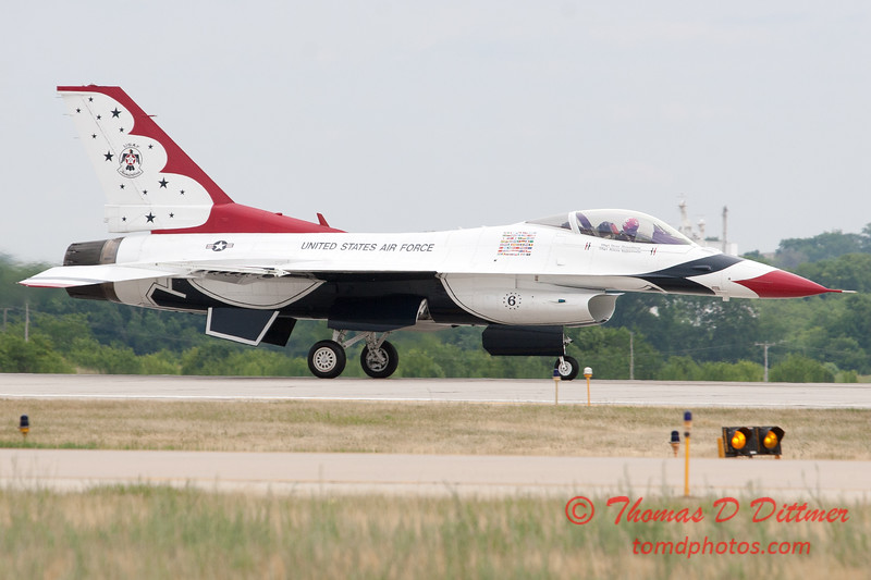 1228 - US Air Force Thunderbirds return to earth after their Sunday performance in F16 Fighting Falcons at the 2012 Rockford Airfest - Chicago Rockford International Airport - Rockford Illinois - Sunday June 3rd 2012