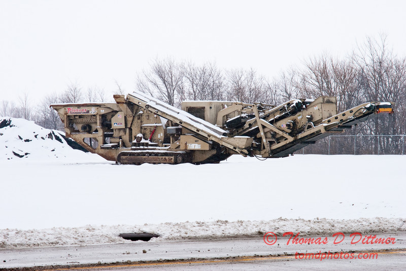 2011 - 1/11 - Idle road repair equipment in the snow - Normal Illinois -  1