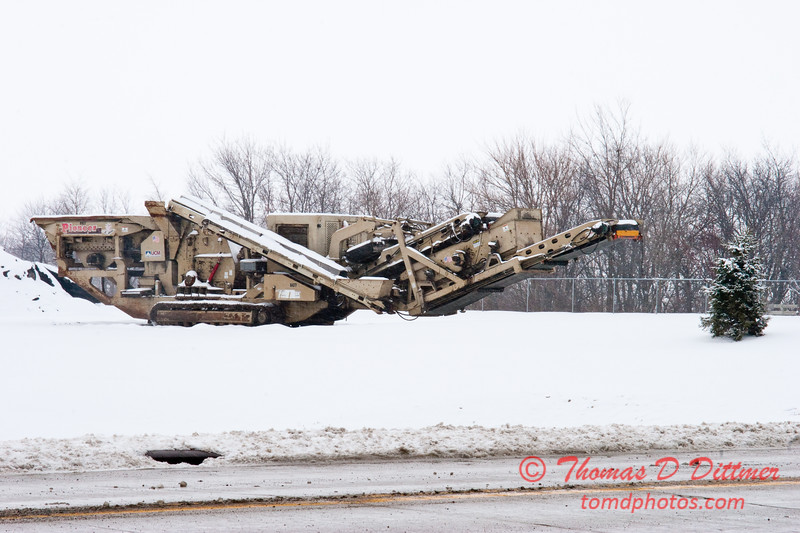 2011 - 1/11 - Idle road repair equipment in the snow - Normal Illinois -  2