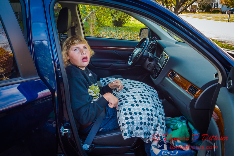 (# 4) Aubrey in the passenger seat of our Mitsubishi Outlander