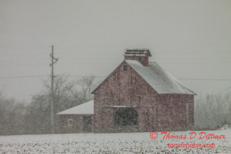 # 36 - Snow falling over farm buildings near Evergreen Lake Hudson Illinois
