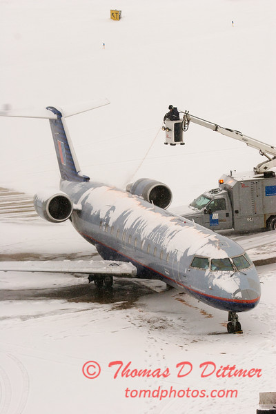 35 - United Express deicing at the gate prior to departure - Greater Peoria Regional Airport - Peoria Illinois - Sunday January 25th 2009