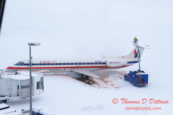 1 - American Eagle is deiced at the gate prior to departure - Greater Peoria Regional Airport - Peoria Illinois - Sunday January 25th 2009