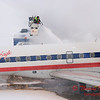 6 - American Eagle is deiced at the gate prior to departure - Greater Peoria Regional Airport - Peoria Illinois - Sunday January 25th 2009