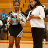 8 - Decatur Eisenhower Senior Cheerleader with her parents honored between the jv and varsity Normal Community Ironmen vs Decatur Eisenhower Panthers Basketball game at Stephen Decatur Middle School