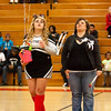 10 - Decatur Eisenhower Senior Cheerleader with her parents honored between the jv and varsity Normal Community Ironmen vs Decatur Eisenhower Panthers Basketball game at Stephen Decatur Middle School