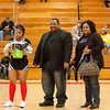 13 - Decatur Eisenhower Senior Cheerleader with her parents honored between the jv and varsity Normal Community Ironmen vs Decatur Eisenhower Panthers Basketball game at Stephen Decatur Middle School