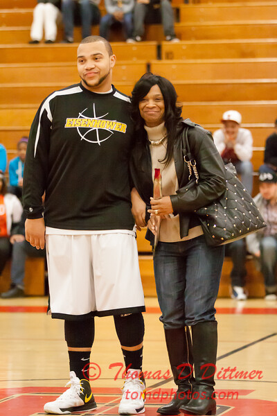 15 - Decatur Eisenhower Senior Basketball Player with his parents honored between the jv and varsity Normal Community Ironmen vs Decatur Eisenhower Panthers Basketball game at Stephen Decatur Middle School