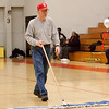 """1 - School staff """"dust"""" the gym floor between the jv and varsity Normal Community Ironmen vs Decatur Eisenhower Panthers Basketball game at Stephen Decatur Middle School"""