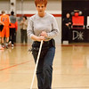 """2 - School staff """"dust"""" the gym floor between the jv and varsity Normal Community Ironmen vs Decatur Eisenhower Panthers Basketball game at Stephen Decatur Middle School"""