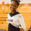 52 - A cheerleader takes a break during the Normal Community Ironmen vs Decatur Eisenhower Panthers Junior Varsity Basketball game at Stephen Decatur Middle School