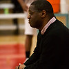 3 - Coach watches his players prior to the Normal Community Ironmen vs Decatur Eisenhower Panthers Junior Varsity Basketball game at Stephen Decatur Middle School