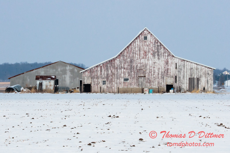 Farm building observed on a winter day in rural McLean County Illinois
