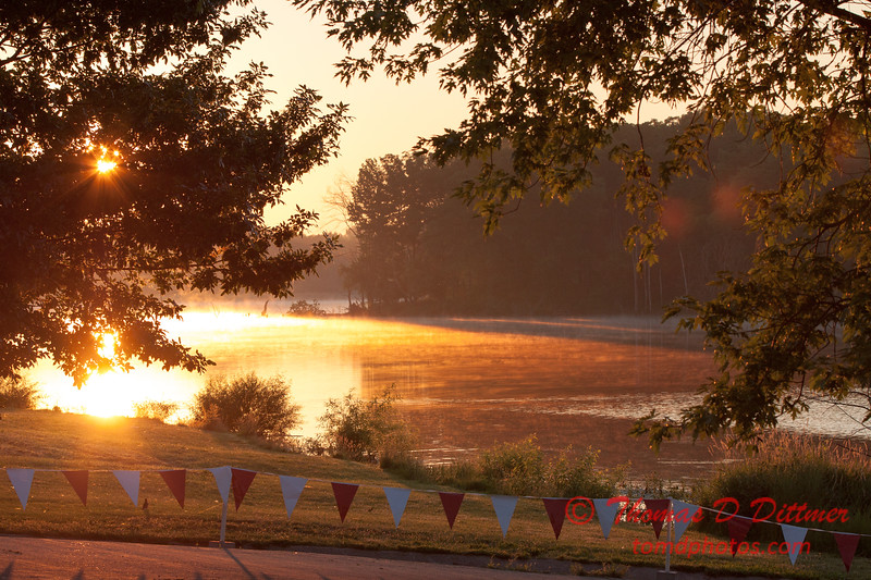 Sunrise over Evergreen Lake in Comlara Park