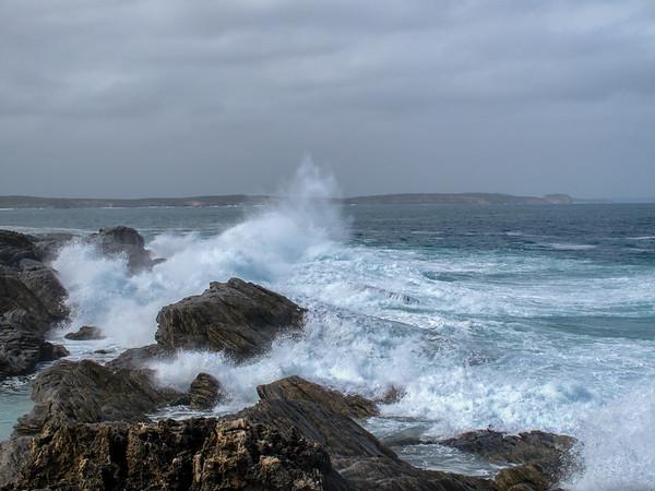 Waves crashing upon rocks