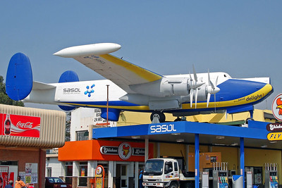 (1723) Shackelton MR3 ex SAAF ('Sasol' colours). Mounted on a petrol station in Devland, Near Soweto.