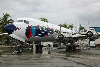 (N836D) DC-7B (45345) Historical Flight Foundation Inc. Being restored into vintage Eastern Airways colours, with re-paint recently completed. Was grounded in 1972 at St. Paul, before restoration to flying condition on 7/8/04 and arriving here the following day via Atlanta-Peachtree.