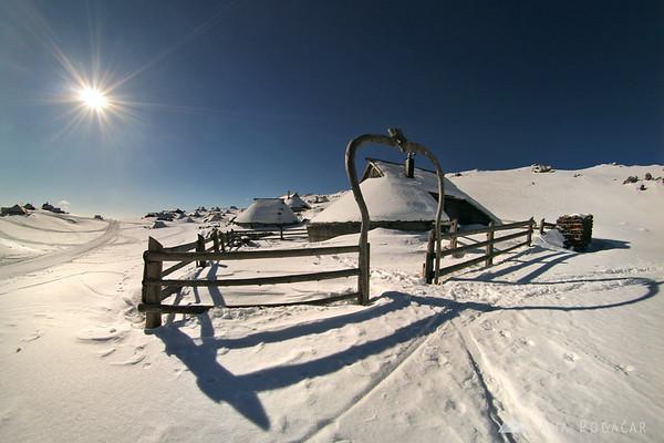 Hiking around snowy Velika planina
