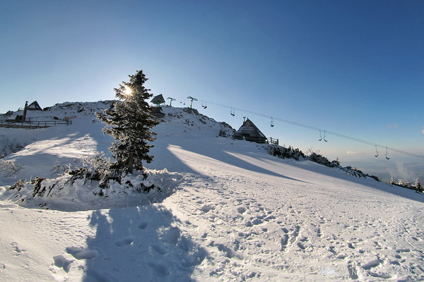 Hiking around snowy Velika planina