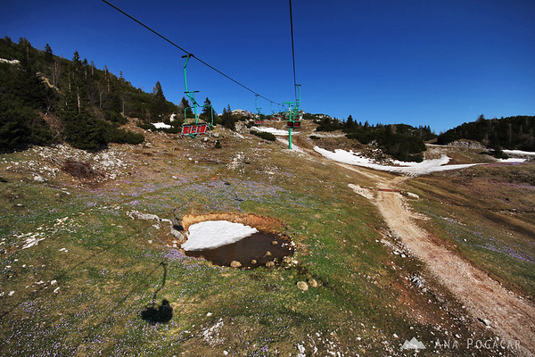 Taking a chairlift to the top of Velika planina