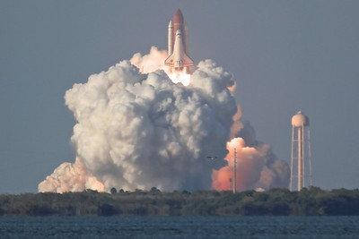 Space Shuttle 'Discovery' (OV-103) launching on mission STS-133 at 16.53:24 from Launch Pad LC-39A, Kennedy Space Center