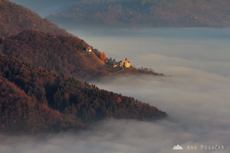 St. Primož church just above the fog