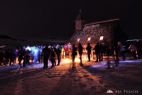 Velika planina chapel at the Christmas midnight mass