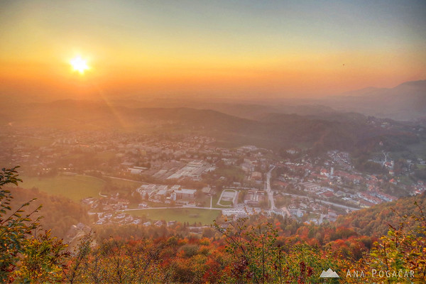 Orange smoggy glow over Kamnik before sunset