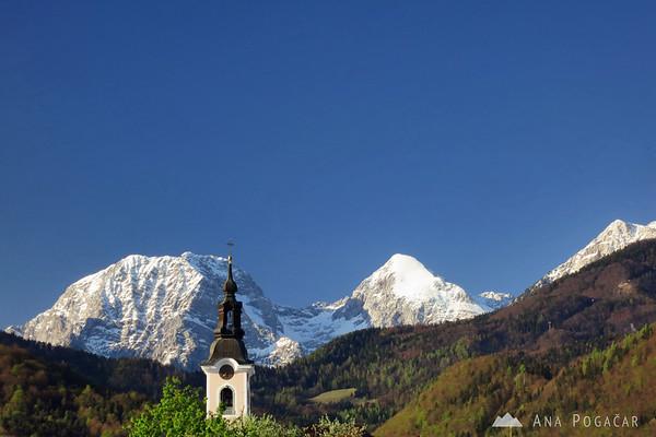 Mt. Kočna and Grintovec behind the church spire in Cerklje