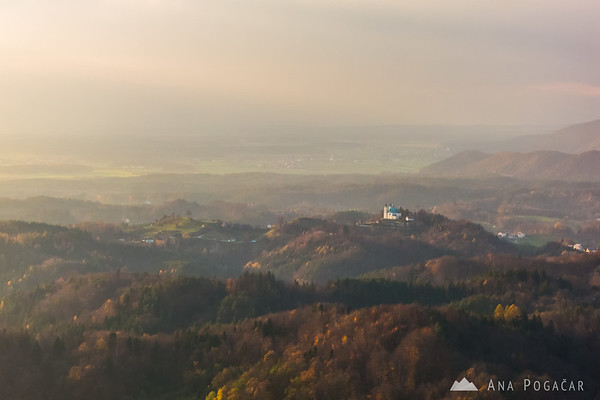 St. Ana church in Tunjice from Špica hill in late afternoon