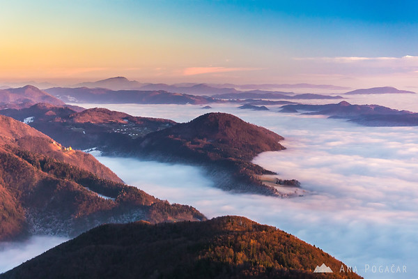 Cold, frosty and foggy valley from Kamniški vrh hill